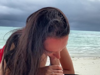 Juicy blowjob from a busty brunette on a desert island