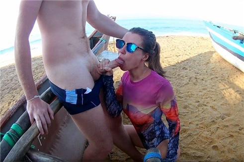 Sexy surfer girl sucks dick on the public beach