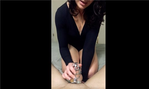 She teases with cock in chastity cage