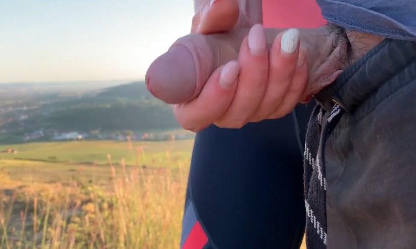 She give handjob on a public hiking trail near many houses