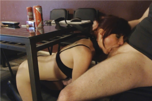 Submissive slutwife gives deep blowjob under table